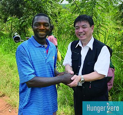 若い農夫と握手.jpg